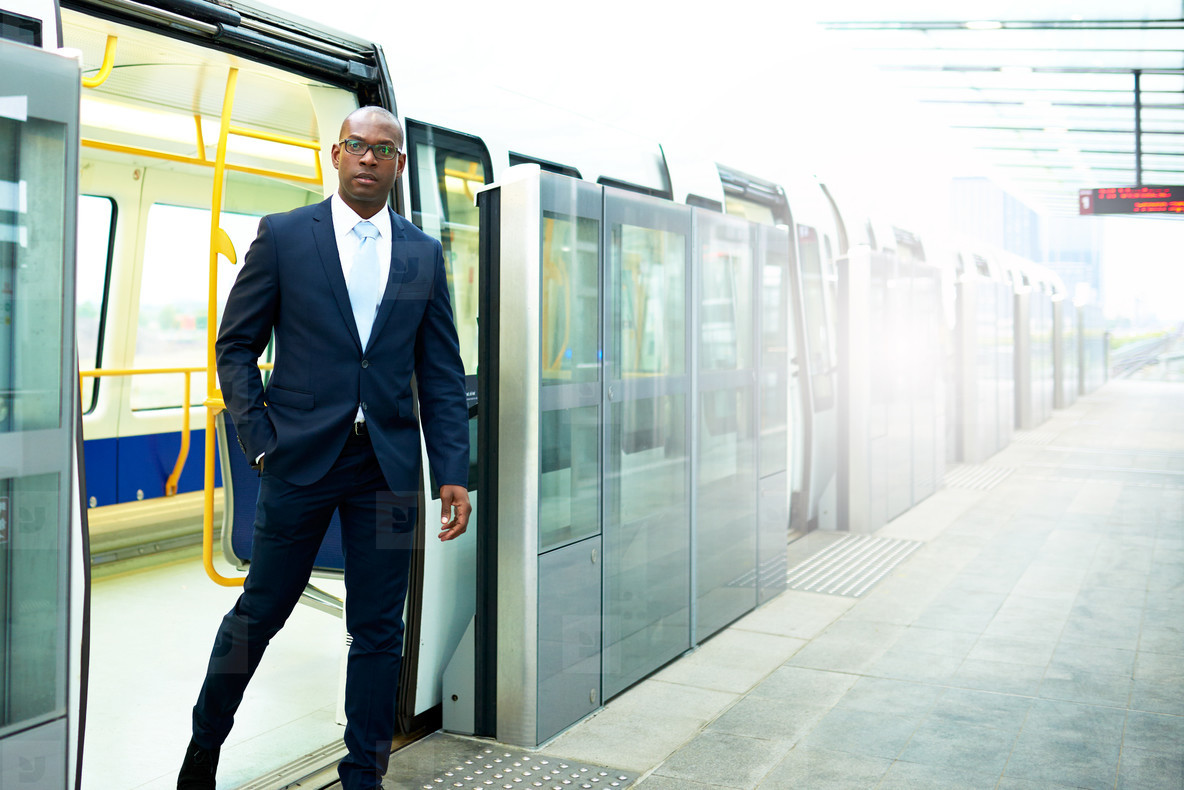 Black American Businessman Going Out From a Train