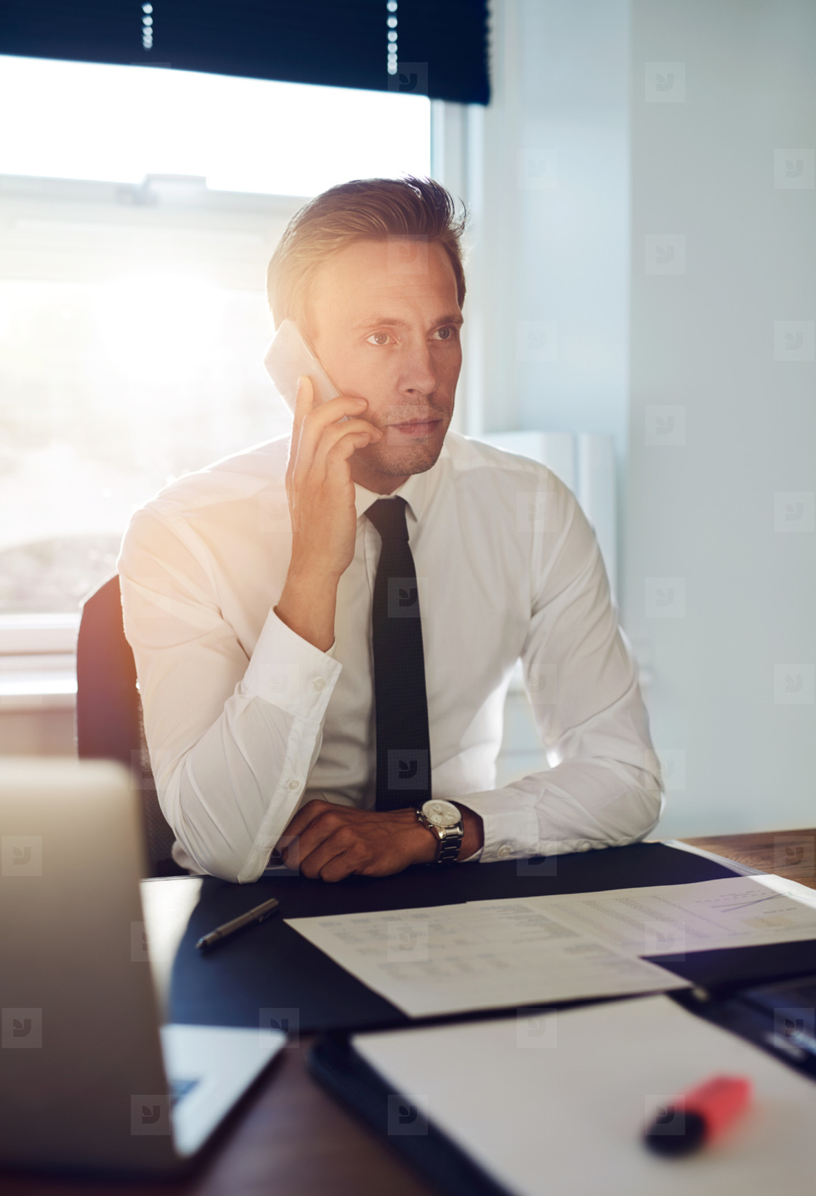 Business man having a conversation on the phone