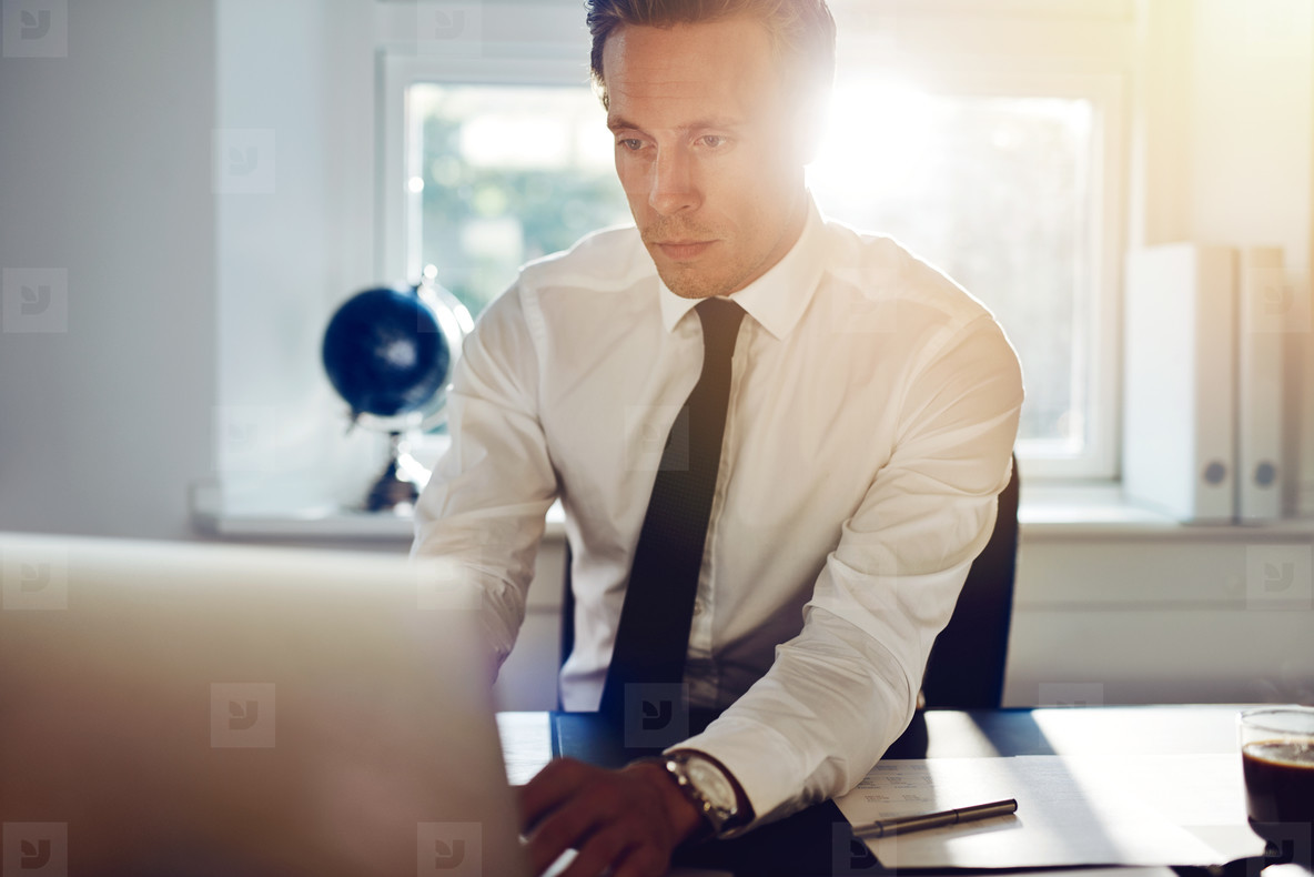 Young white business man working on computer
