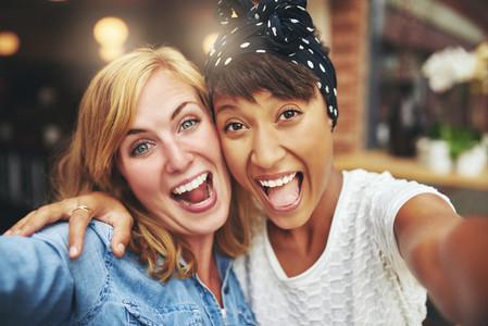 Exuberant happy multi ethnic girl friends
