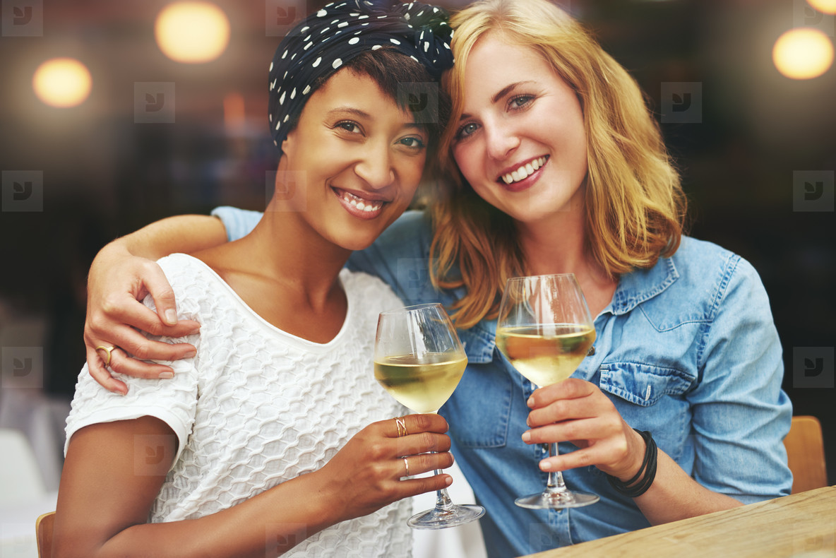 Two gorgeous women enjoying a glass of wine