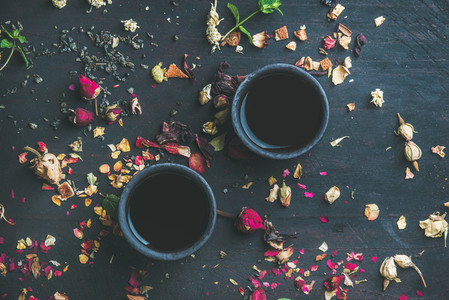 Chinese black tea in stoneware cups with herbs and flowers