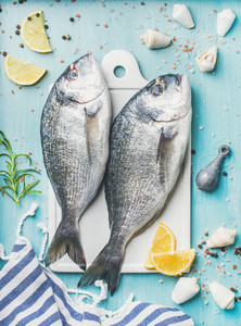 Fresh Sea bream or dorado raw uncooked fish with seasoning