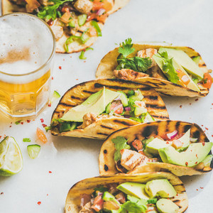 Healthy corn tortillas with grilled chicken  avocado and wheat beer