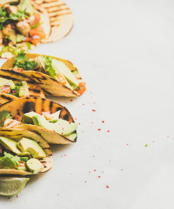 Healthy corn tortillas with grilled chicken  avocado  lime  copy space