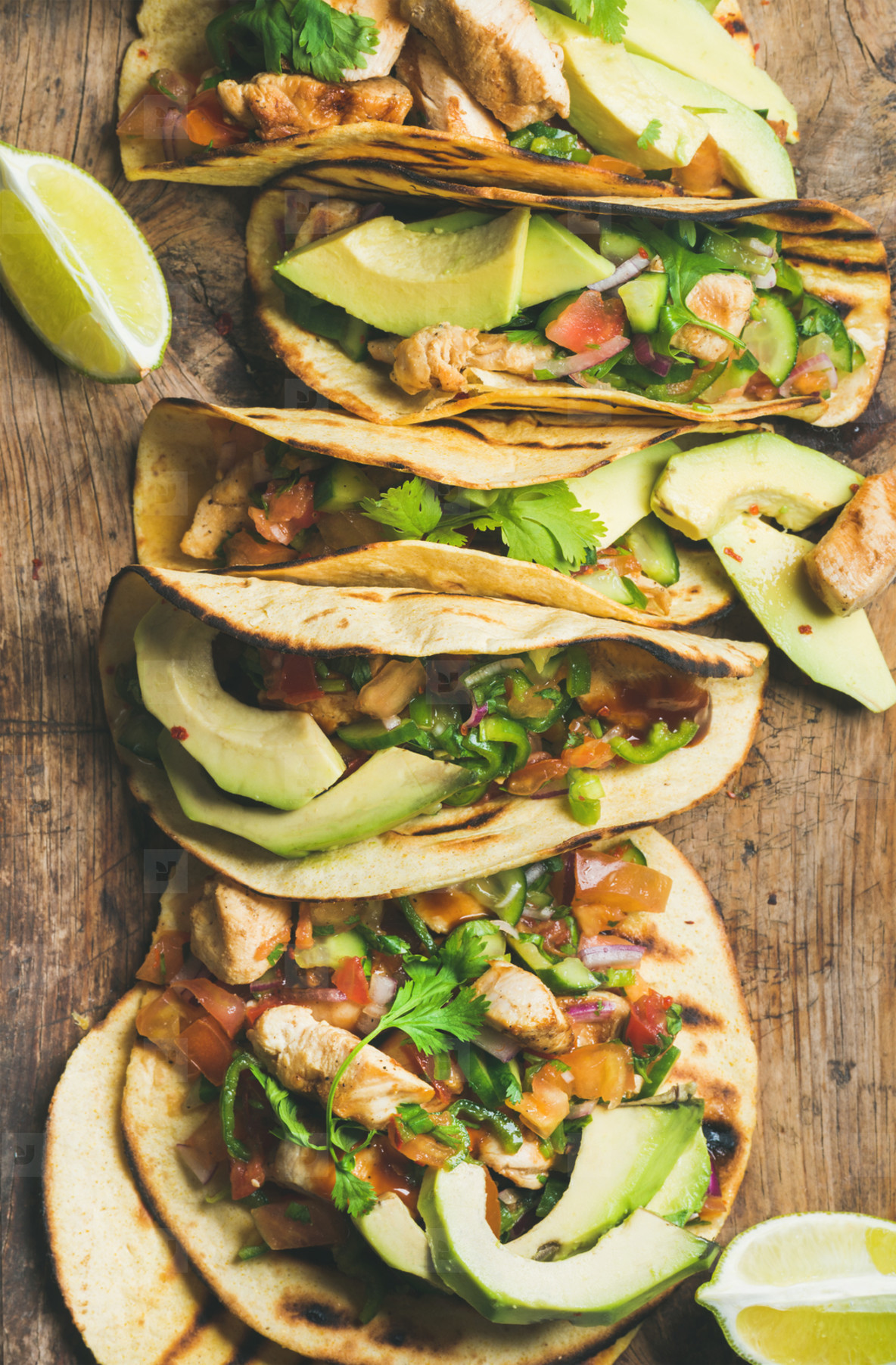 Tacos with grilled chicken  avocado  fresh salsa and limes