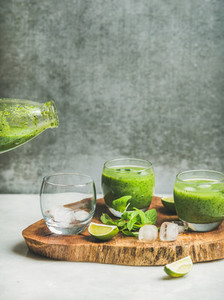 Fresh green smoothie with ice  mint and lime in glasses
