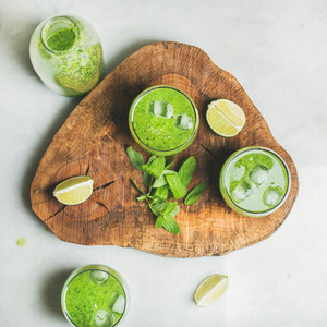 Fresh green smoothie with ice cubes  mint and lime