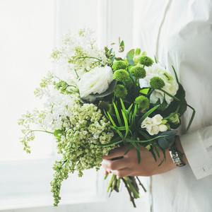 Young woman wearing white clothes holding flowers bouquet Wedding concept