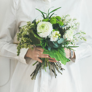 Young woman wearing white clothes holding bouquet  Square crop