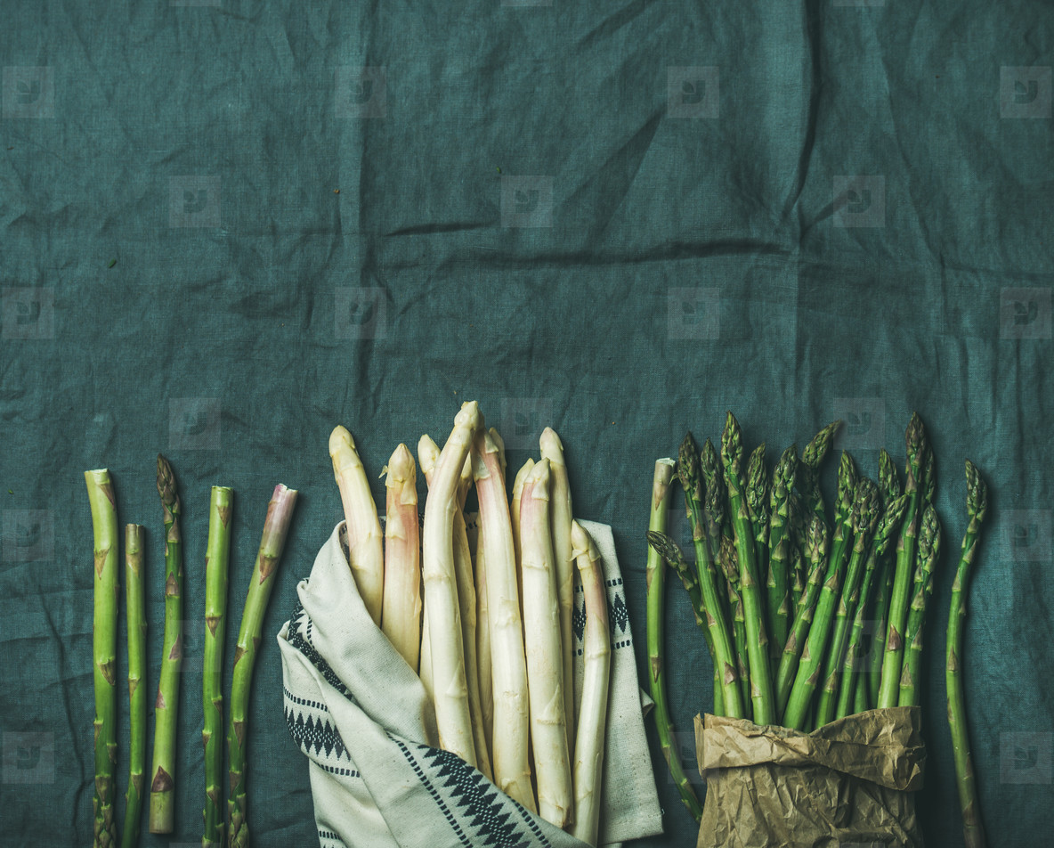 Fresh green and white asparagus in towel  copy space
