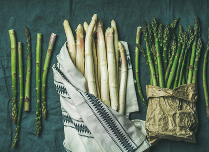 Fresh green and white asparagus in towel grey background