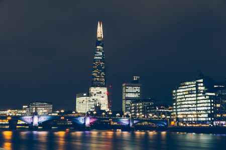 London skyline at night with shard building and reflections on R