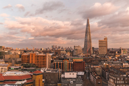 Modern London skyline with shard building horizon at sunset on c