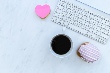 Computer keyboard coffee and love heart with copy space on white