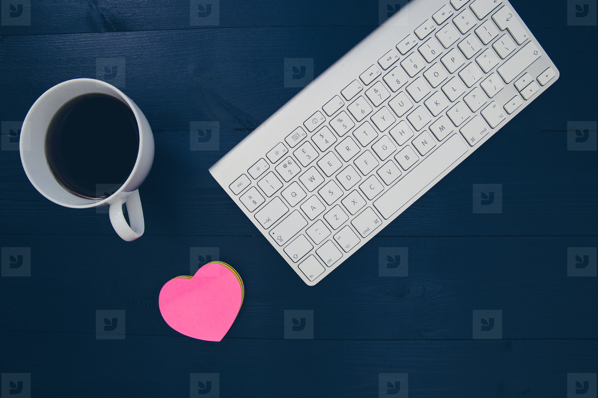 Computer keyboard coffee and love heart on wood workspace desk