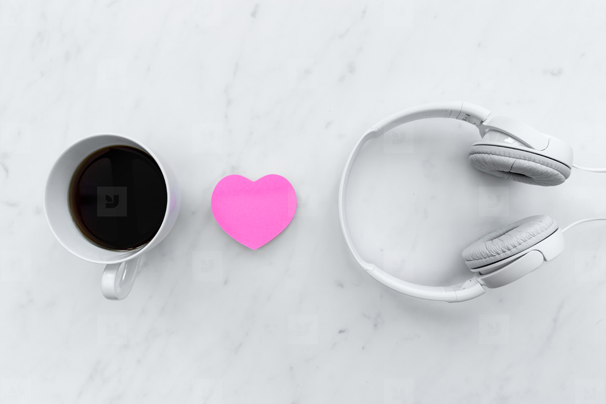 Love music concept with pink love heart shape and white headphon