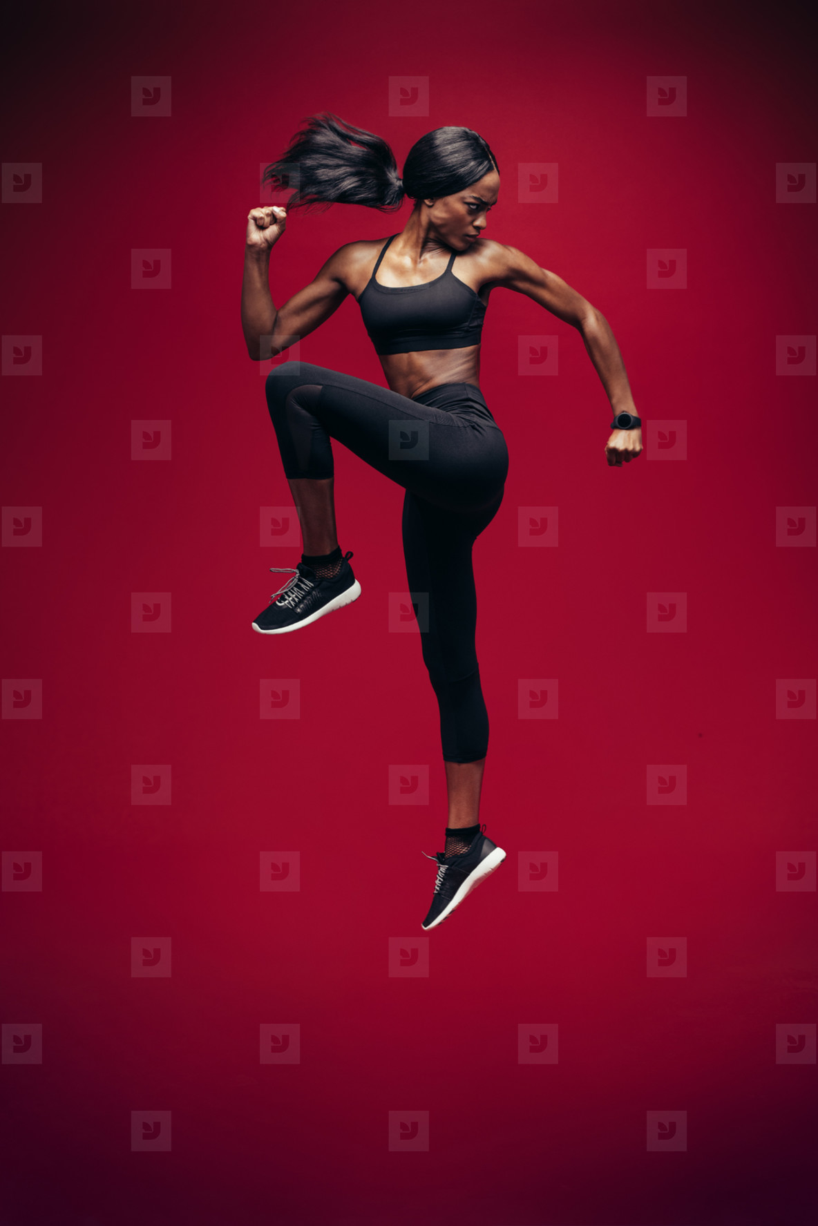 Healthy african woman jumping and exercising
