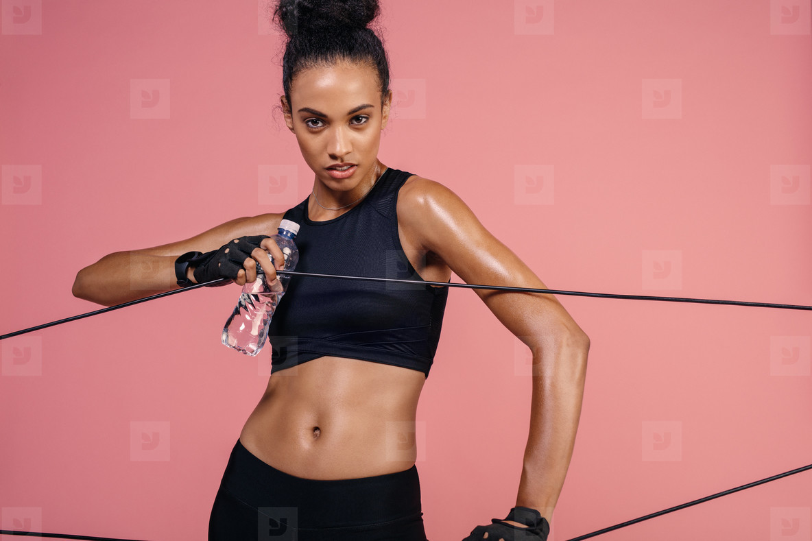 Strong woman exercising with elastic band