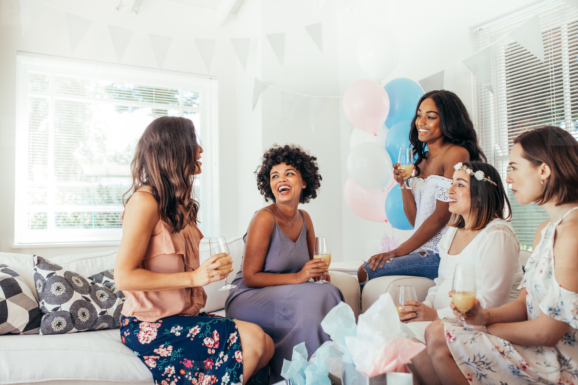 Female friends having fun at baby shower