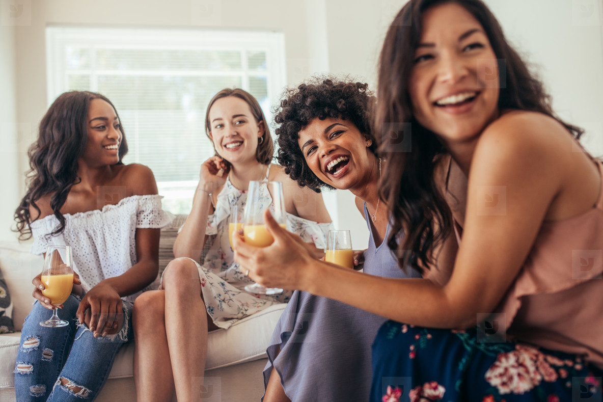 Diverse group of female friends enjoying at a party