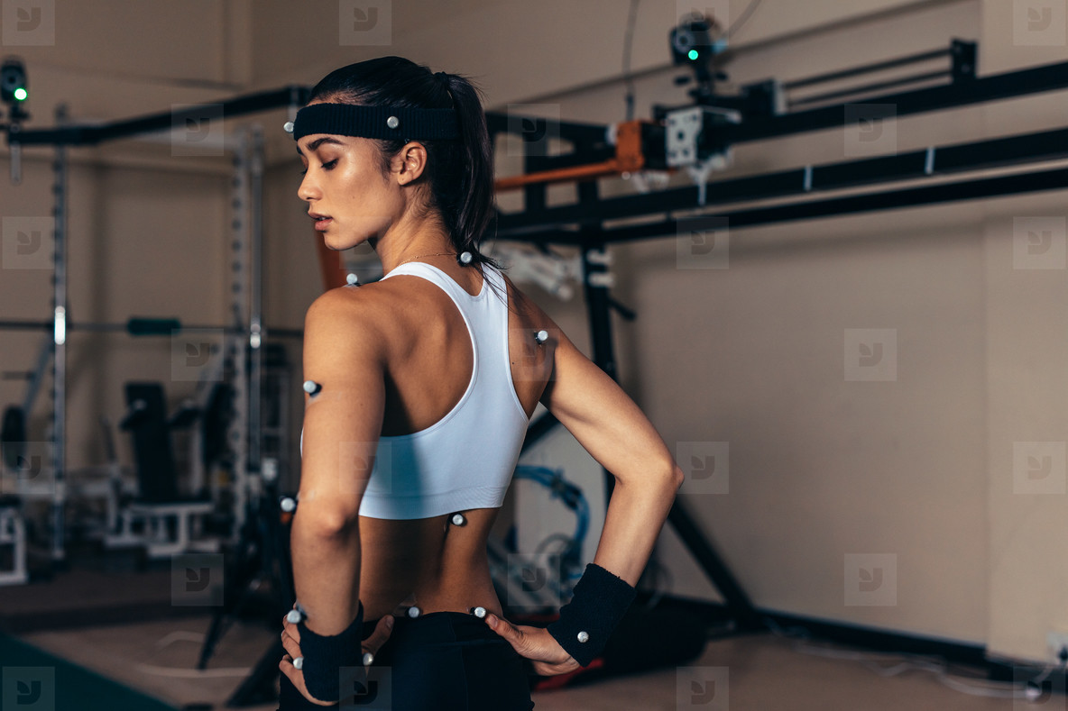 Sportswoman with motion capture sensors