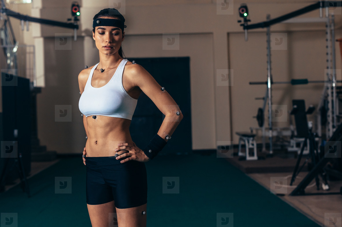 Female athlete with motion capture sensor