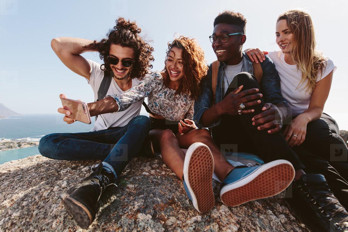 Friends on mountain top taking selfie