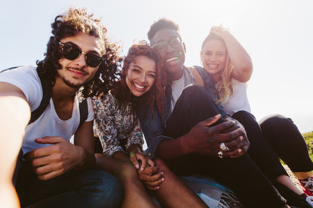 Smiling friends taking selfie on a holiday