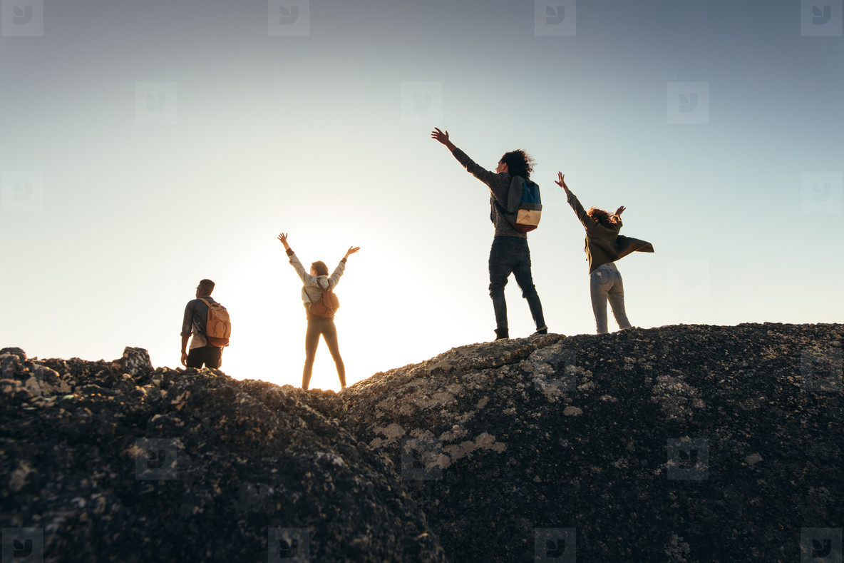 Friends enjoying the view from mountain top