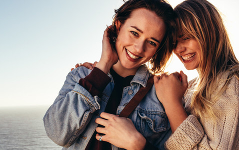 Cheerful female friends on holidays outdoors