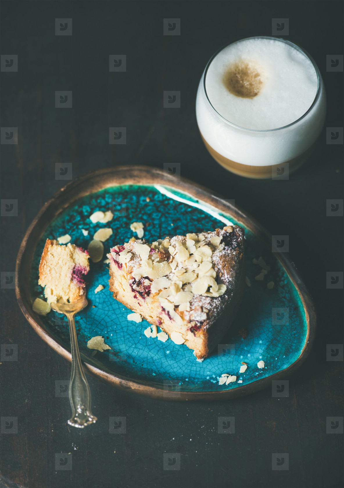Piece of lemon  ricotta  almond  raspberry cake and coffee