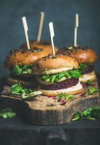 Healthy homemade vegan burger with beetroot quinoa patty  arugula  avocado sauce