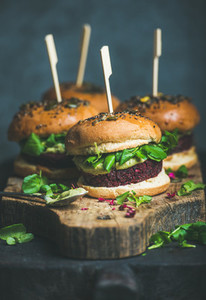Healthy homemade vegan burger with beetroot quinoa patty  arugula  avocado sauce