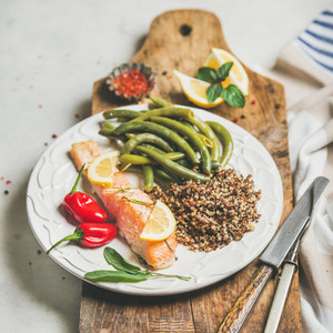 Healthy protein rich dinner plate with roasted salmon and quinoa