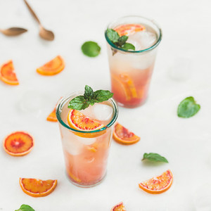 Blood orange fresh lemonade with ice and mint  square crop