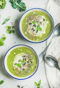 Spring broccoli cream soup with fresh mint and coconut cream