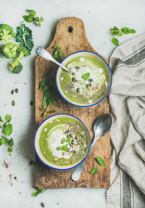 Spring vegetarian broccoli cream soup with mint and coconut cream