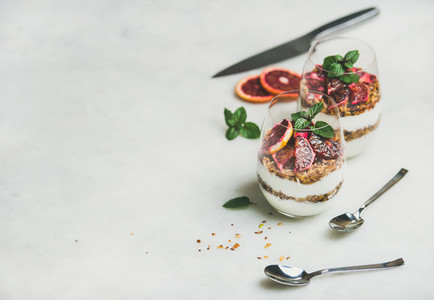 Greek yogurt granola blood orange layered parfait in glasses
