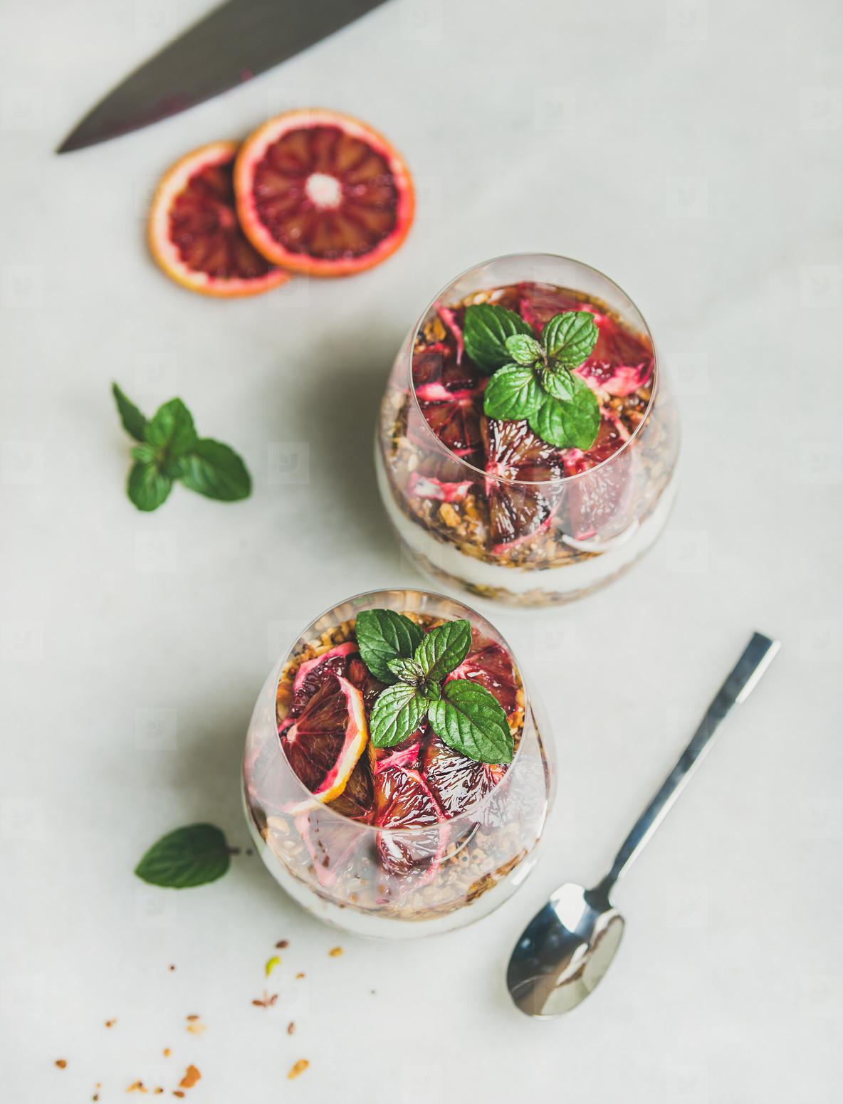 Healthy breakfast with greek yogurt  granola  orange layered parfait