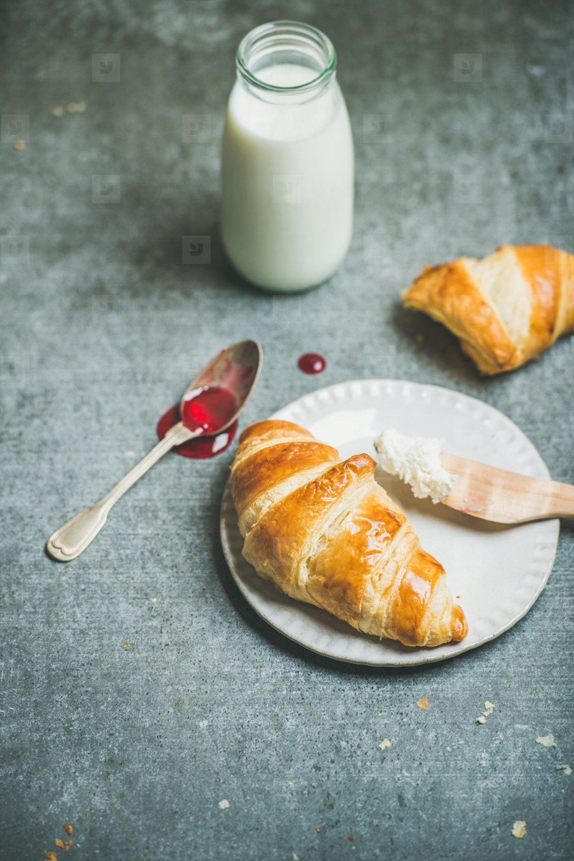Croissants with raspberry jam  ricotta cheese and milk  copy space