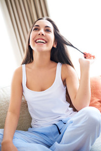 Woman laughing and playing with hair