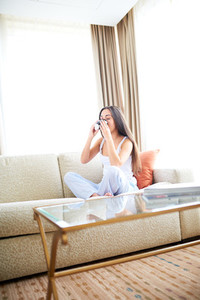 Woman enjoying a warm drink and relaxing