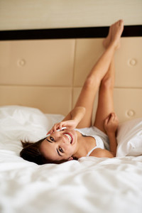 Woman lying upside down looking back smiling