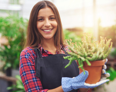 Smiling employee at a flower nursery