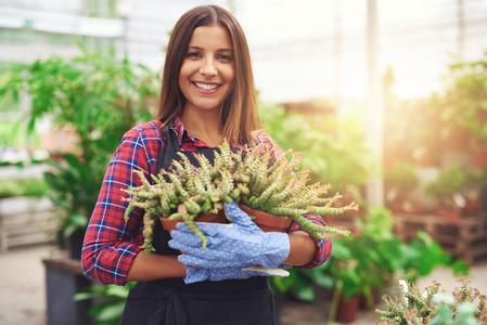 attractive nursery owner in her greenhouse