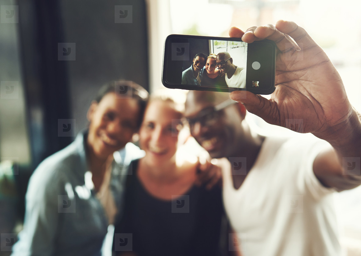 Multi ethnic friends taking a selfie