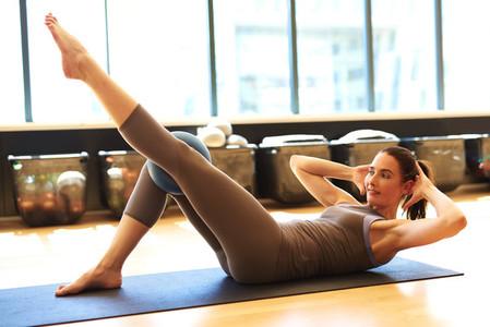 Attractive brunette in gym