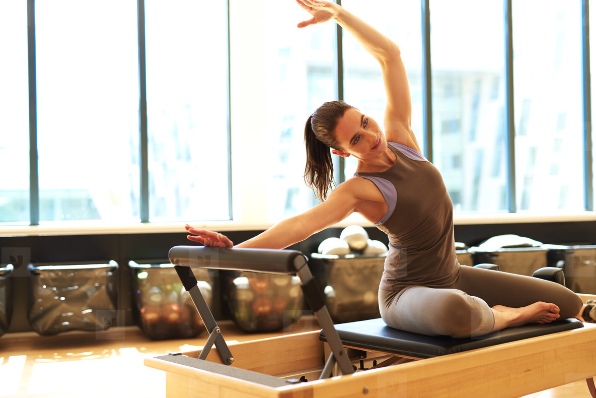 Attractive brunette in pilates class