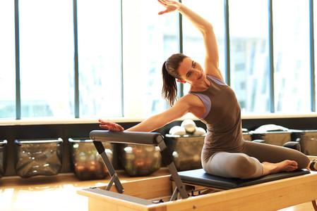 Attractive brunette in pilates class
